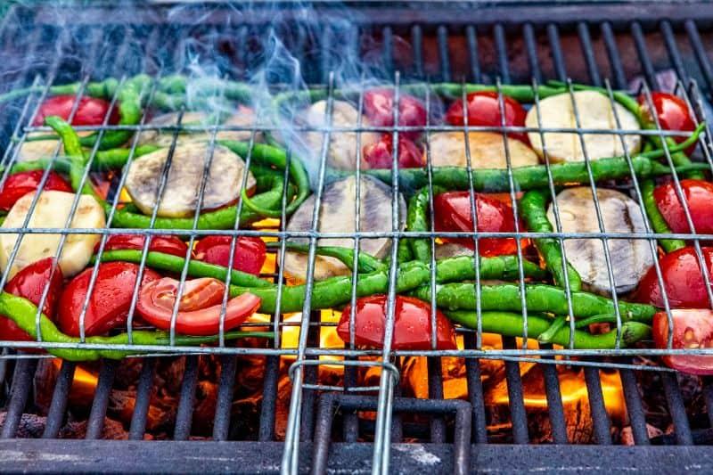 vegetables being BBQ'd in grilling basket