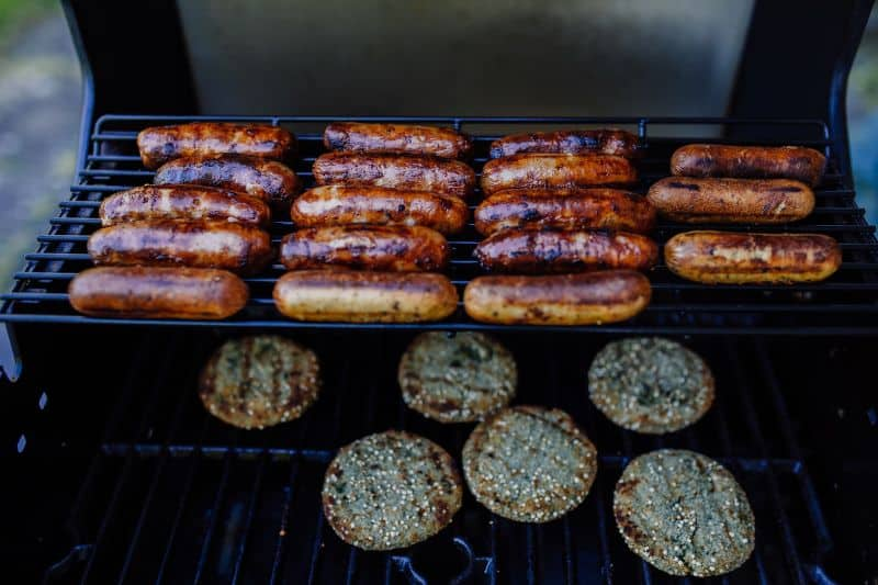 burgers and sausages on BBQ