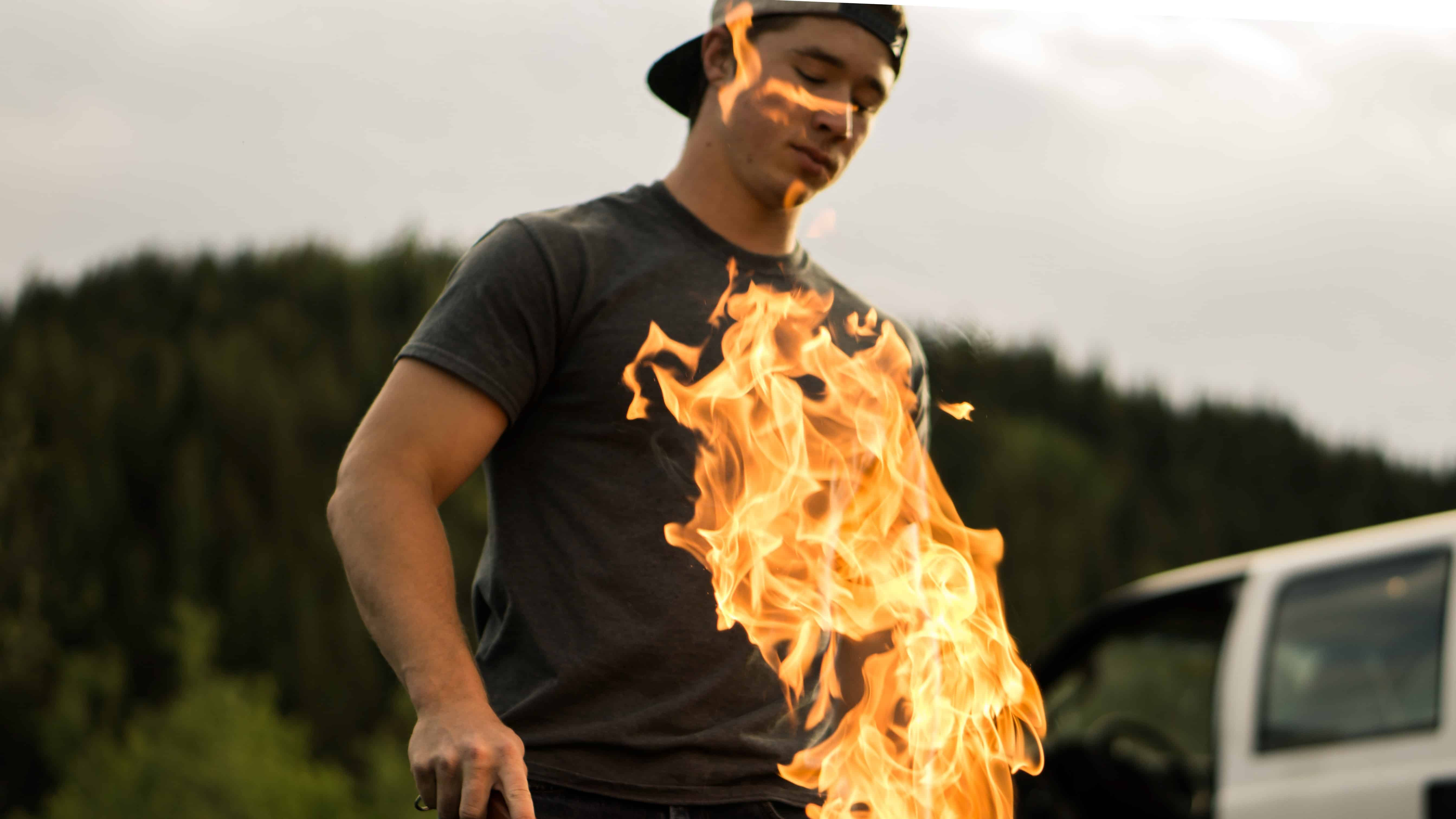 man bbq'ing with flames obscuring him