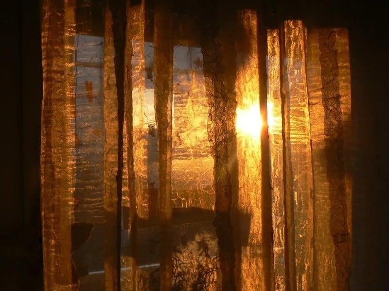 sun shining through curtains in the shade